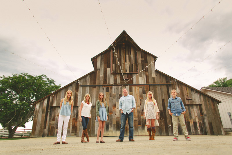 (Greengate Ranch) family standing outside of barn