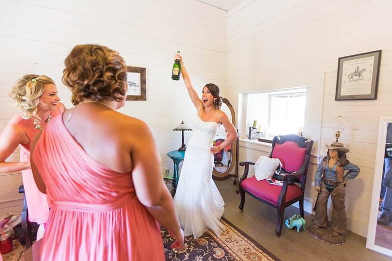Santa Margarita Ranch Bride opening champagne