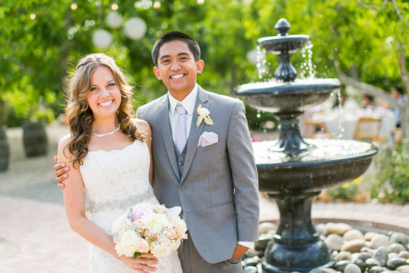 Peacock Farms Wedding Bride and Groom next to a fountain
