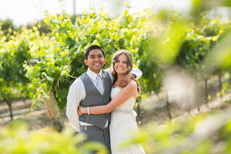 Peacock Farms Wedding Bride and Groom in a vineyard (3 of 3)