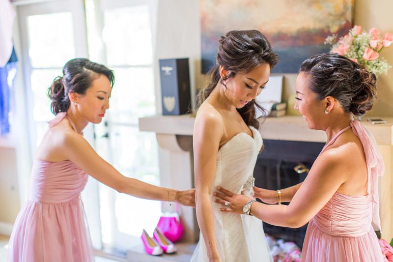 Bernardus Winery Wedding Bride putting her dress on