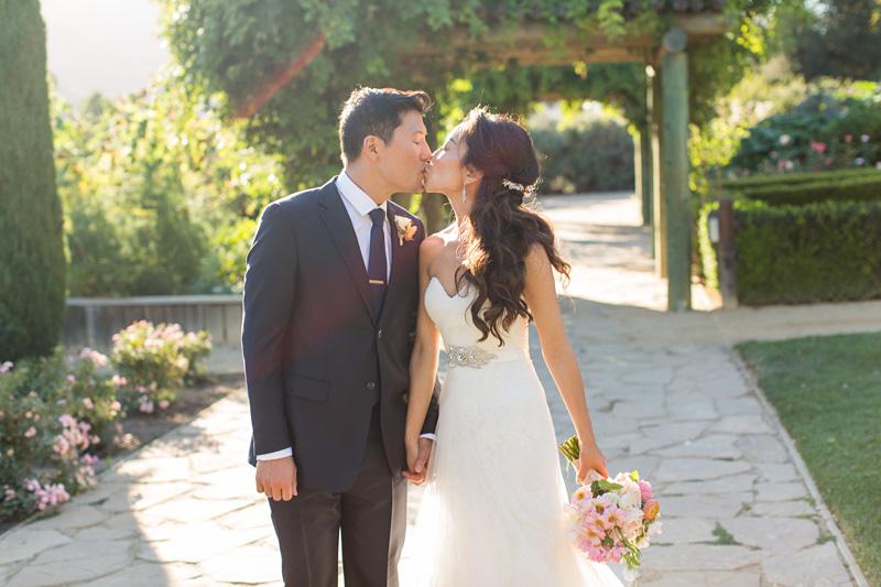 Bernardus Winery Wedding Groom and Bride kissing in the vineyard