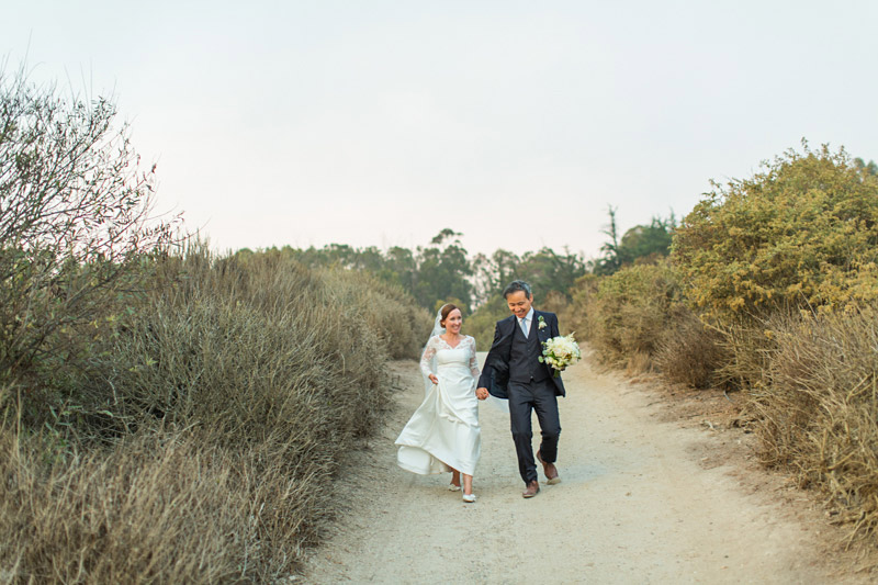 The Stow House Wedding Bride and Groom walking to the beach
