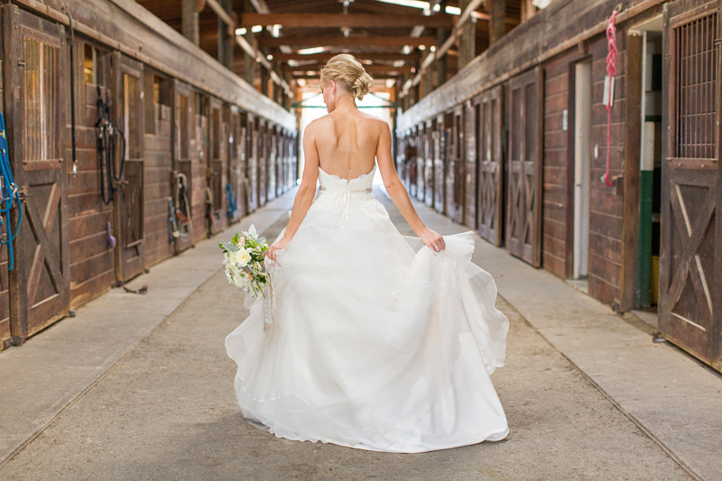 Greengate Ranch Wedding Bride with her bouquet in the barn
