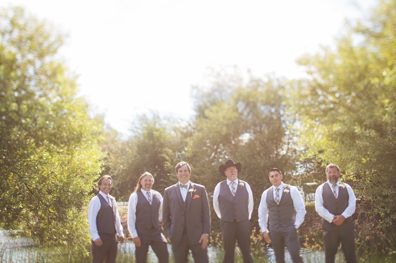 Greengate Ranch Wedding Groom and Groomsmen in the grass field (1 of 2)