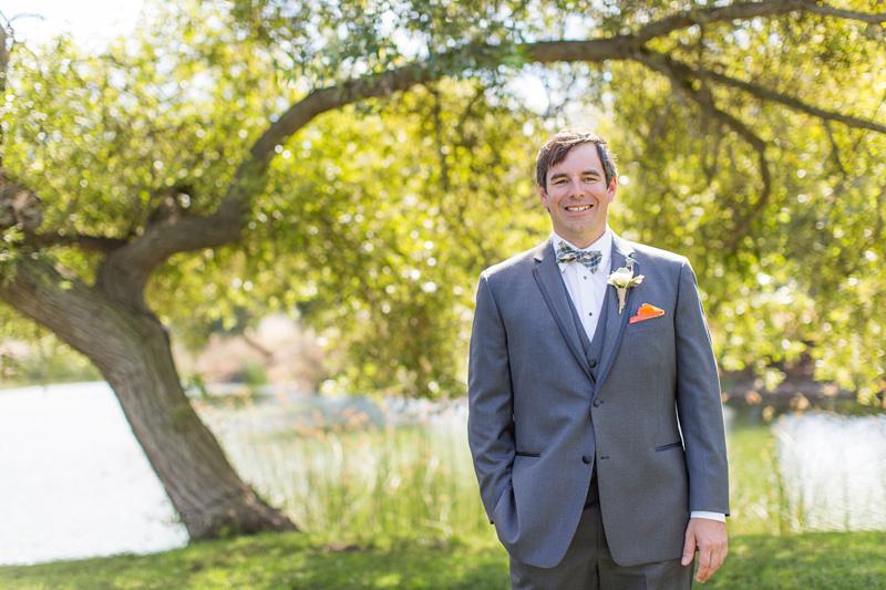 Greengate Ranch Wedding Groom in green field