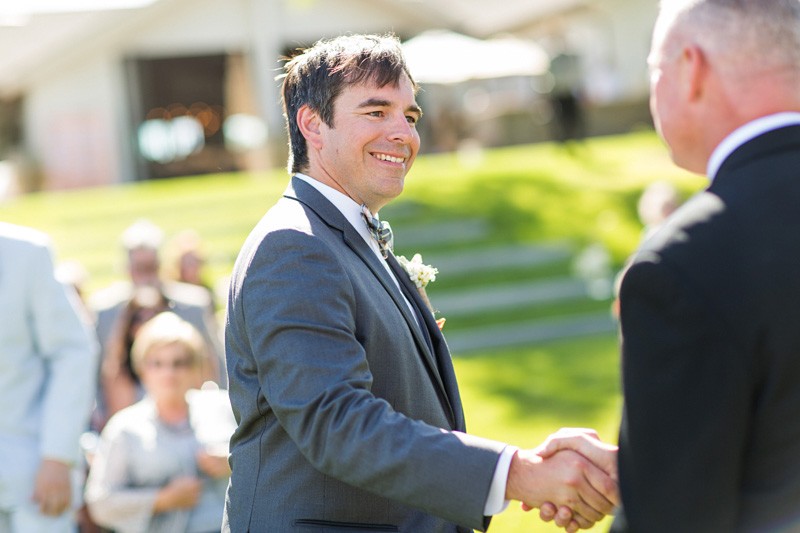 Greengate Ranch Wedding Groom shaking the hand of the officiant