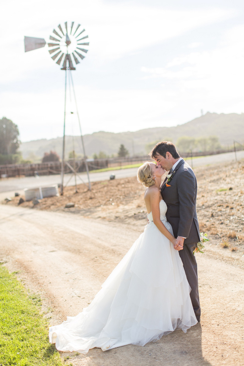 Greengate Ranch Wedding Bride and Groom kissing in the field