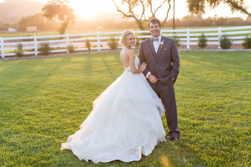 Greengate Ranch Wedding Bride and Groom at sunset in the grass field (3 of 5)