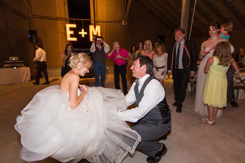 Greengate Ranch Wedding Groom getting the garter