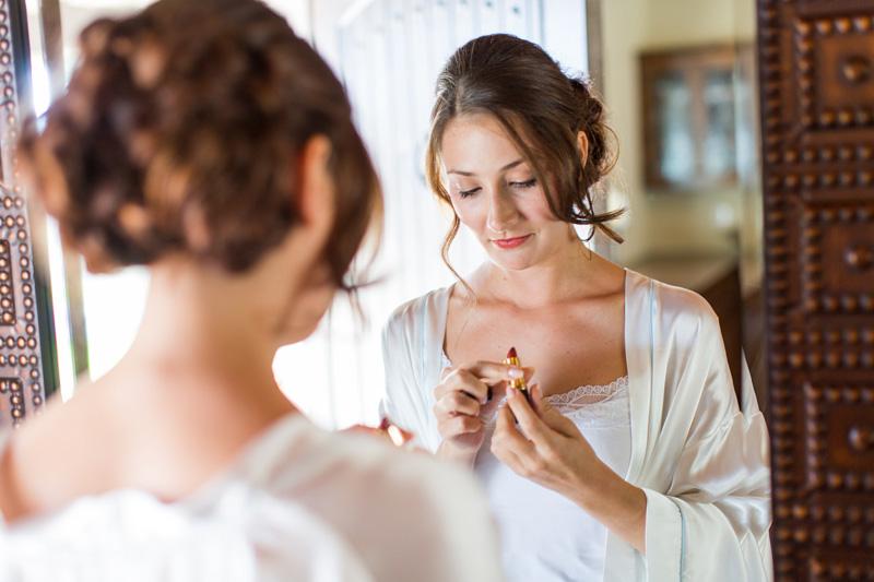 Greengate Ranch Wedding Bride putting lipstick on