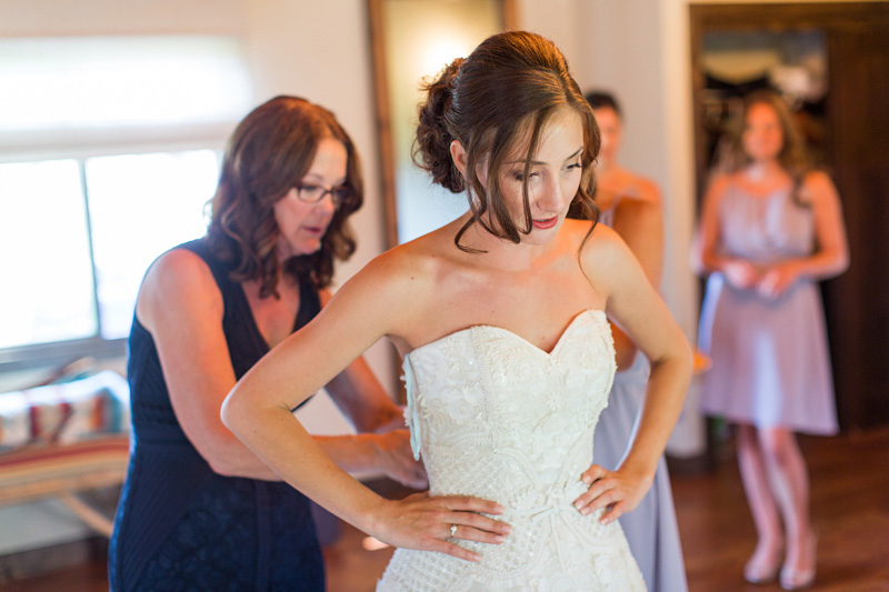 Greengate Ranch Wedding Bride putting her dress on (1 of 2)