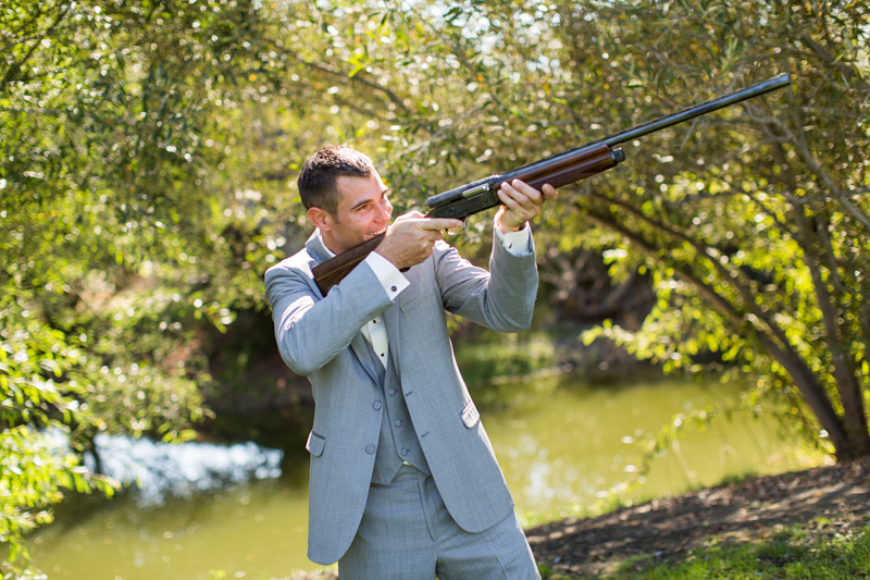 Greengate Ranch Wedding Groom shooting a gun (3 of 4)