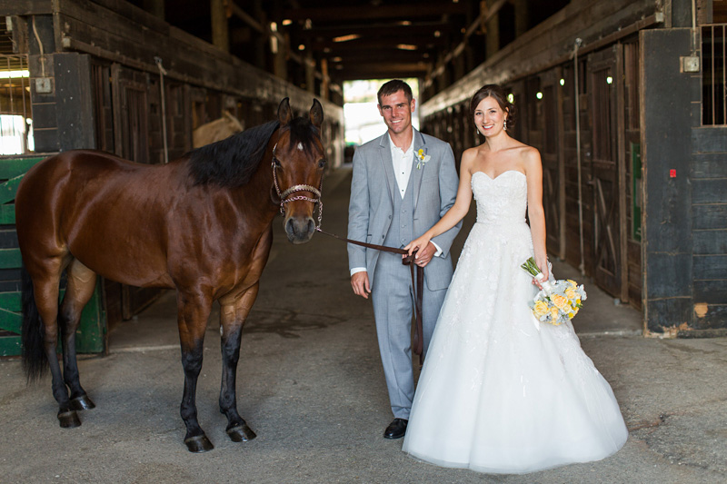 Greengate Ranch Wedding Bride and Groom in the barn with a horse (1 of 4)