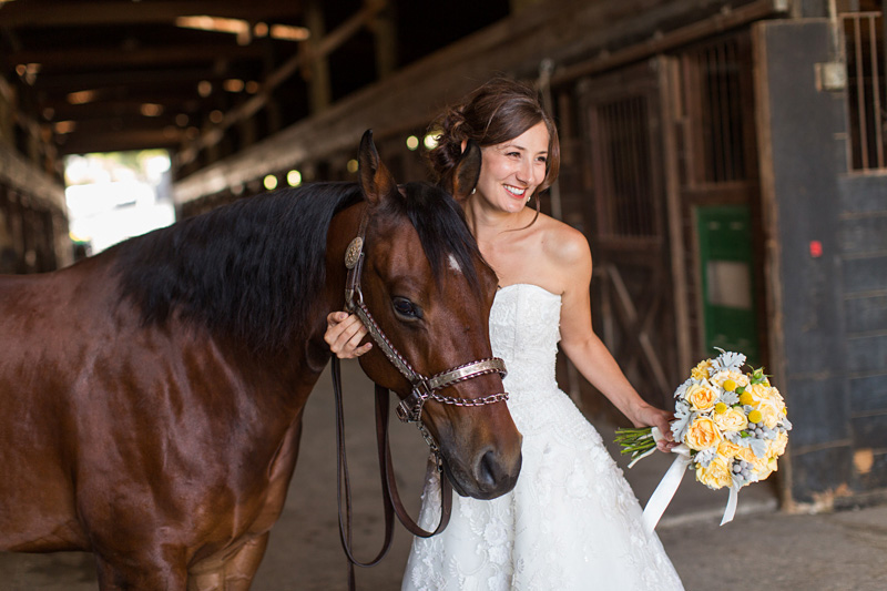 Greengate Ranch Wedding Bride in the barn with a horse (2 of 4)
