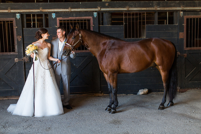 Greengate Ranch Wedding Bride and Groom in the barn with a horse (3 of 4)