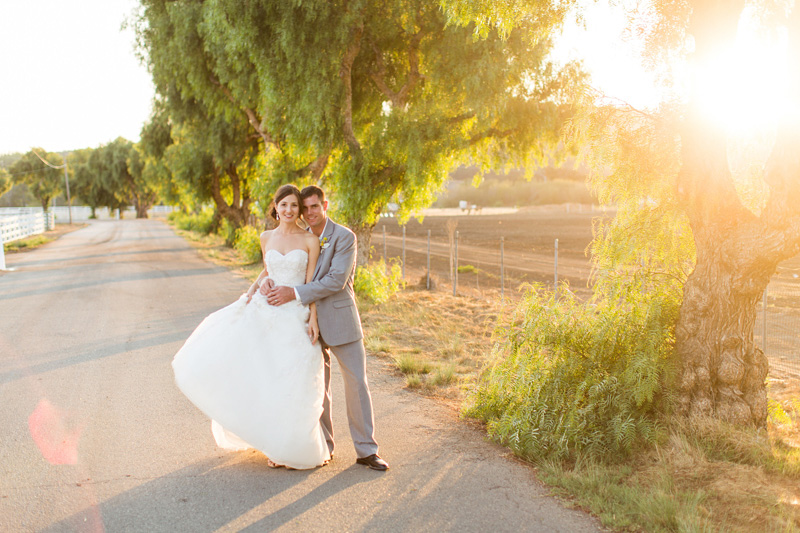 Greengate Ranch Wedding Bride and Groom holding each other at sunset photos (4 of 7)