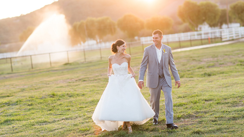 Greengate Ranch Wedding Bride and Groom walking together at sunset photos (7 of 7)