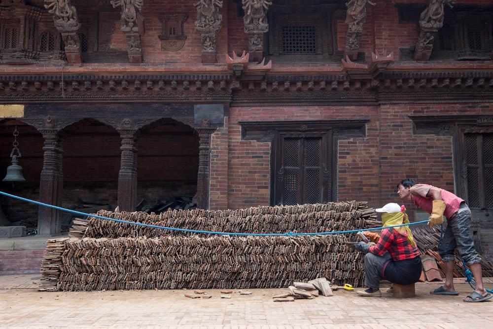 Tile cleaning and repair at the Patan Museum in Patan Durbar Square, Kathmandu, Nepal.