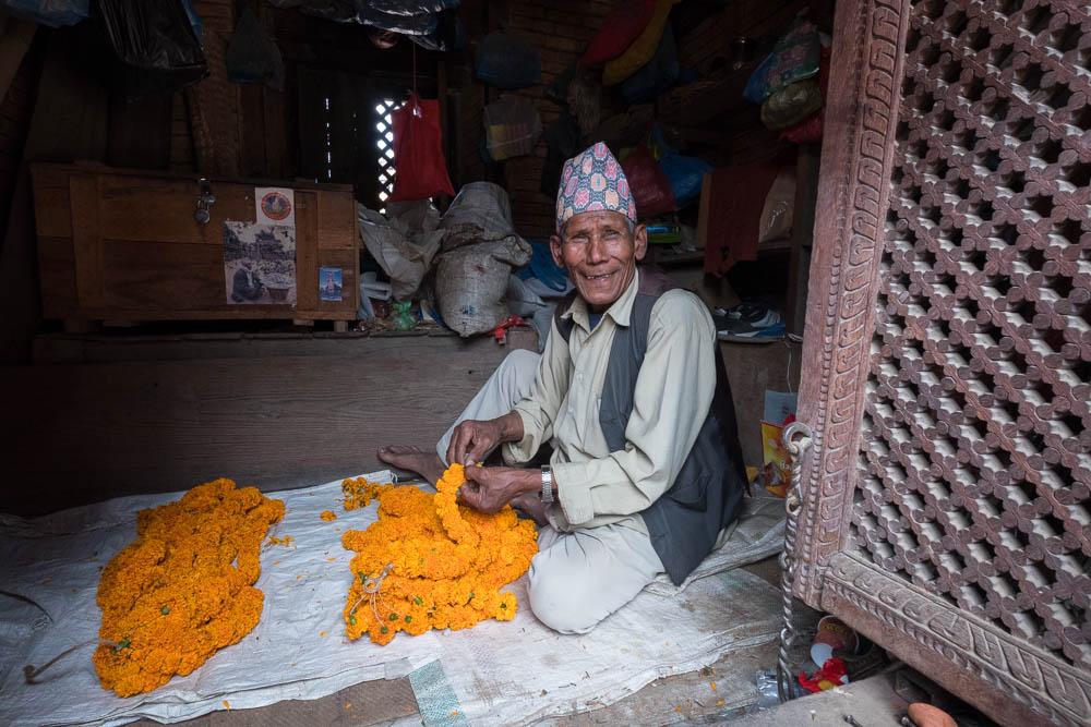 Marigold garland maker, Patan Durbar Square, Kathmandu, Nepal.