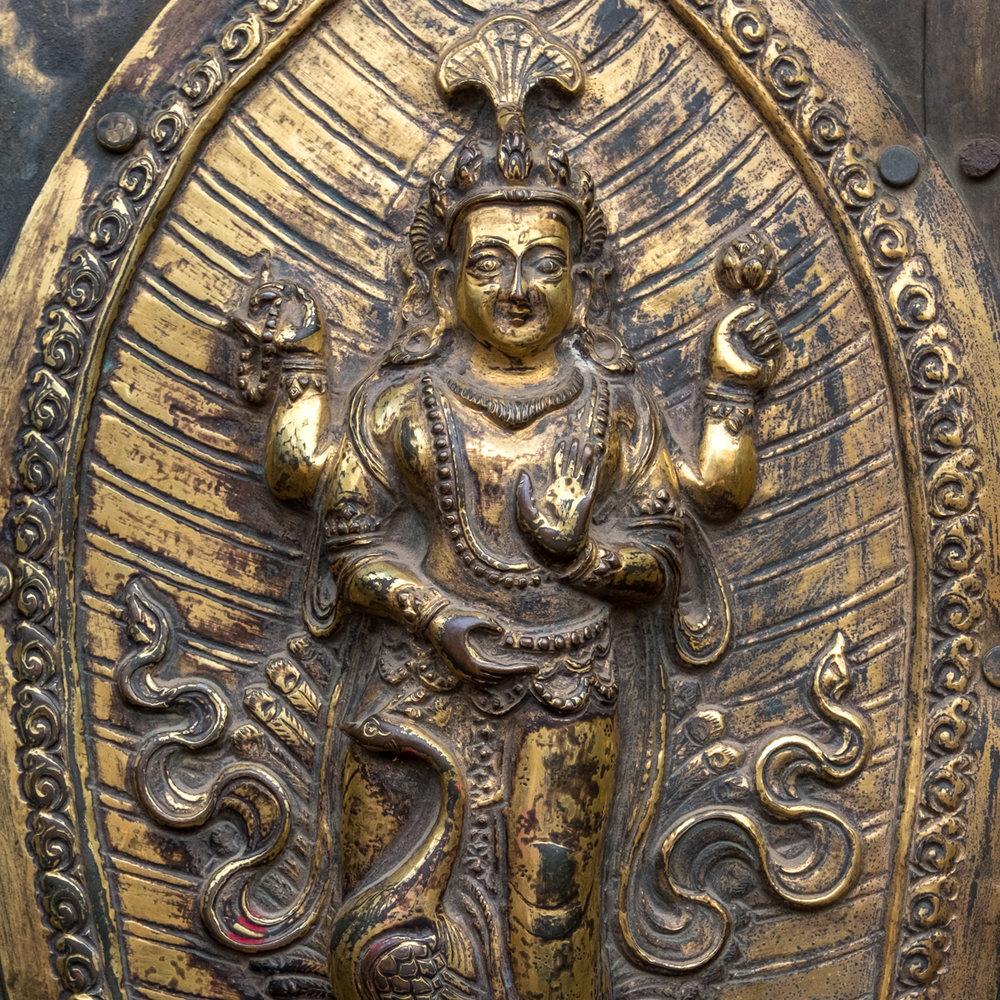Detail on entry door to Patan Museum, Patan Durbar Square, Kathmandu, Nepal.