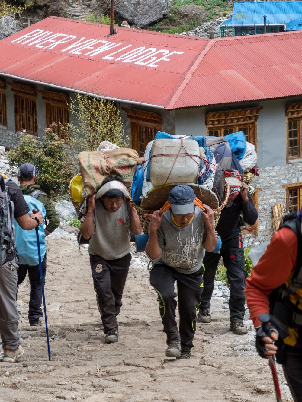 Porters hauling goods in the Khumbu Region, Nepal.