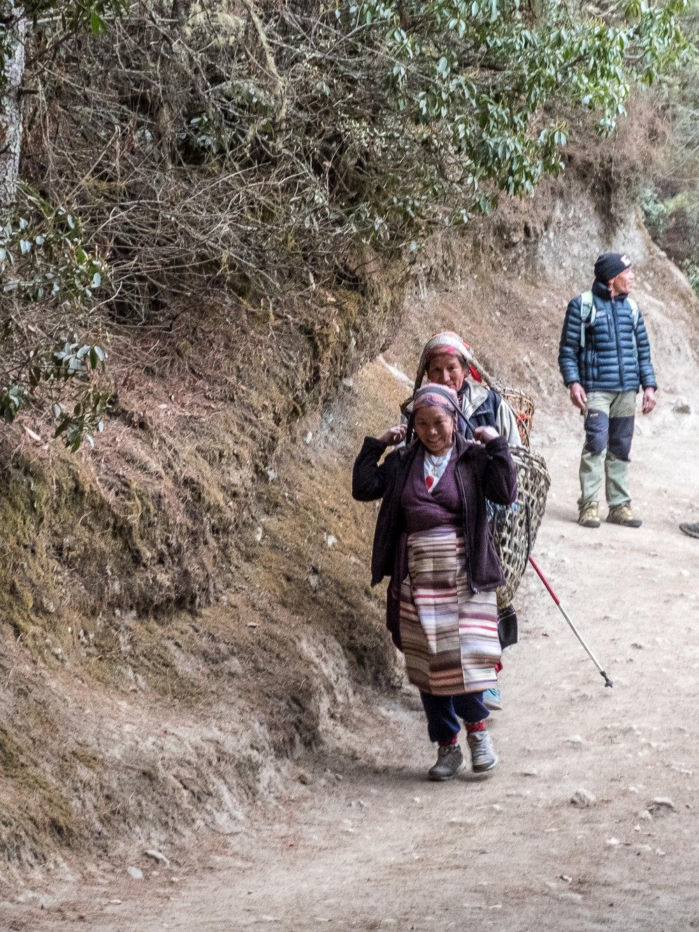 Women carrying goods, Khumbu region, Nepal.