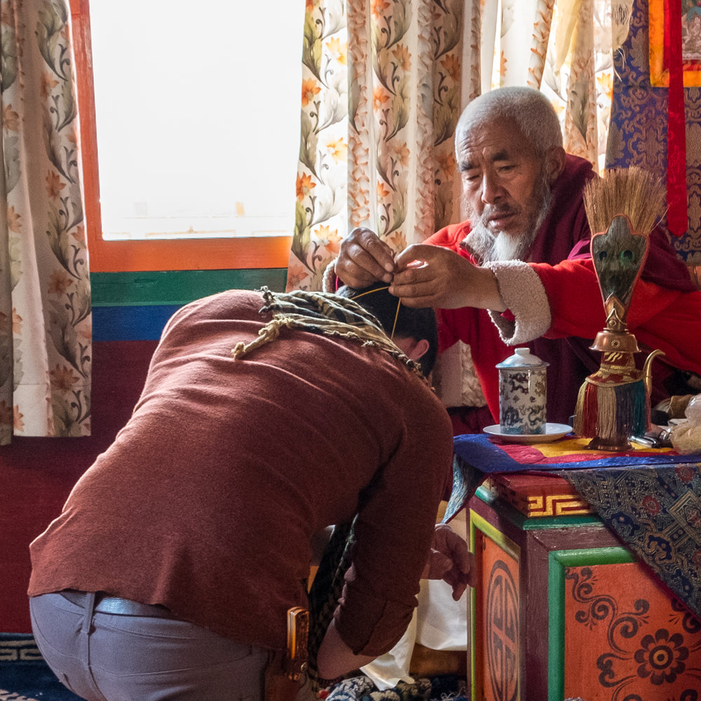 Alex receiving his blessing from Lama Ngawang Paljor.