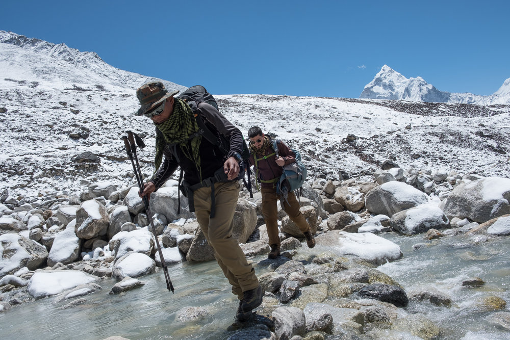Alok and Alex hopping across the icy waters.