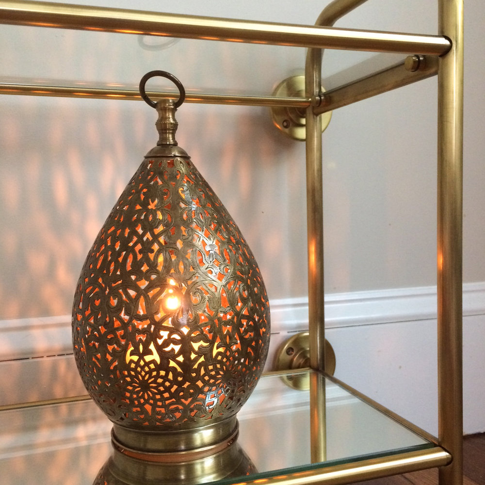 Accessories in progress: Moroccan brass lantern—from Morocco—on Pottery Barn's vintage wall shelf