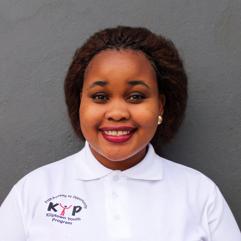 Nelisiwe Walaza: Marketing Manager    nwalaza@kliptownyouthprogram.org.za   Nelly graduated from KYP's tutoring program in 2008. After completing Grade 12 in 2008, she studied Marketing in Business administration at PC Training and Business College for 2 years and graduated in July 2012. In the year 2012 she was chosen as one of the youth to participate in the ILIVE2LEAD women's leadership summit in Nantong, China. She was also the Activist in Residence for Castilleja School in Palo Alto, San-Francisco where she also had the opportunity to visit and work in institutions like Facebook, LinkedIn and Google. In 2016 she pursued a study in Project Management at Wits University. In addition to her role as Marketing Manager, she is also part of KYP's outreach partnership programs, and she is one of the mentors for a girls scholarship program in KZN. Her passion lies in leadership programs and programs that look into developing the youth.