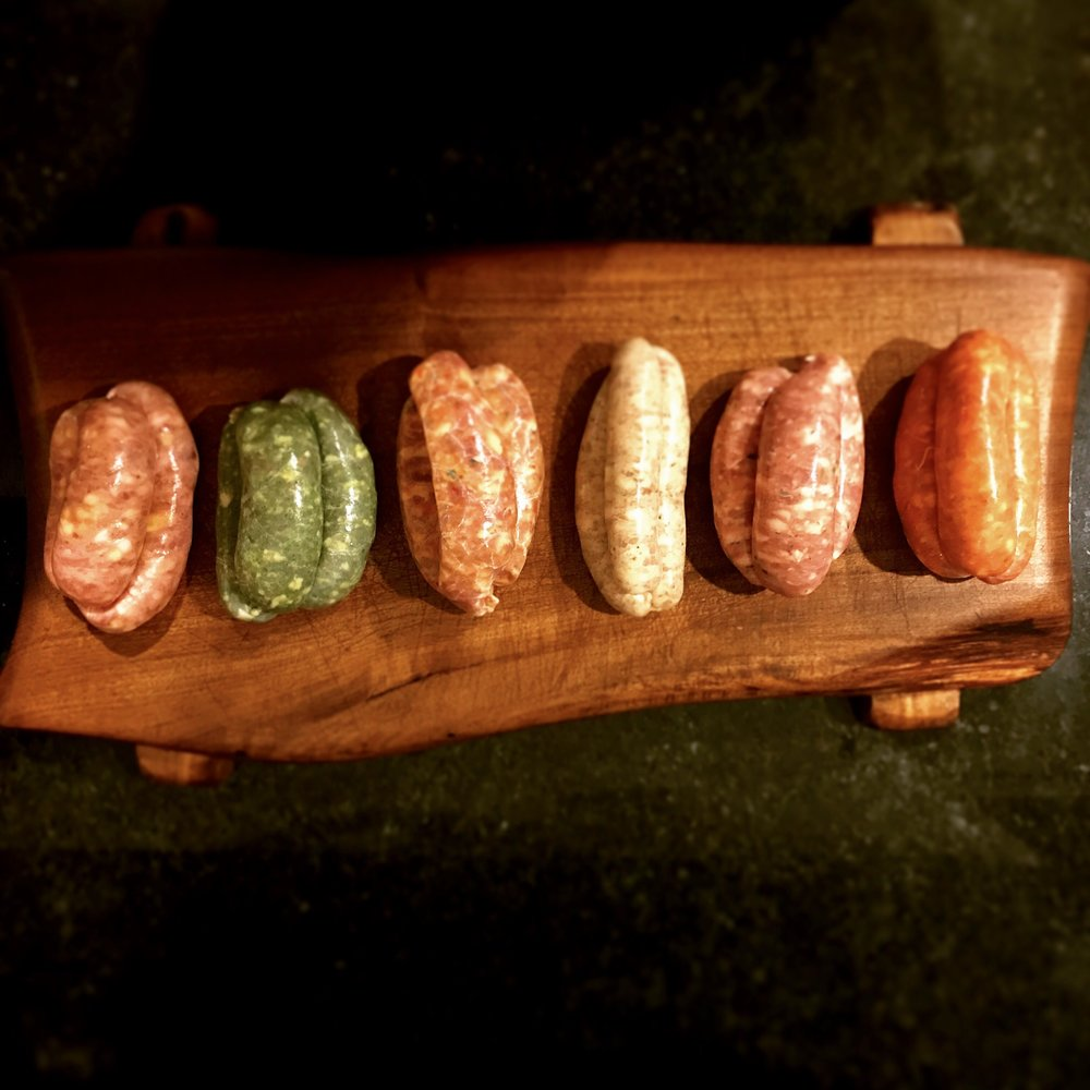 The full range of L'Authentique flexitarian sausages including the Green Chorizo