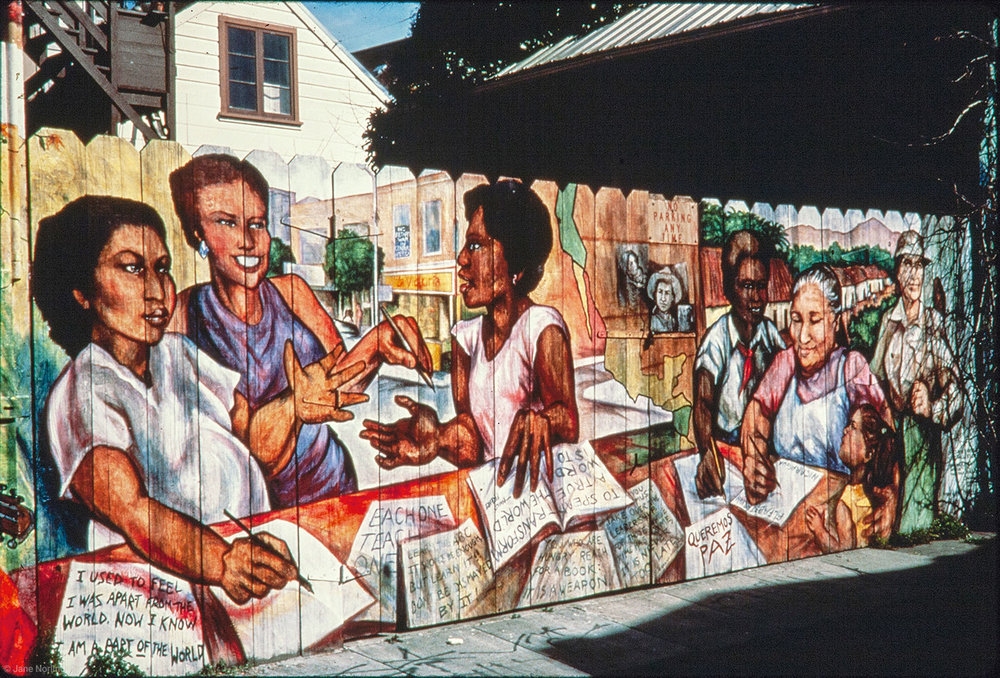 Y Enseñarles a Leer/And Teach Them to Read , PLACA murals project, Balmy Alley, San Francisco, 1984. Painted with Politec mural colors on fence. Removed by landlord 1994, relocated by artists to Berkeley, California.