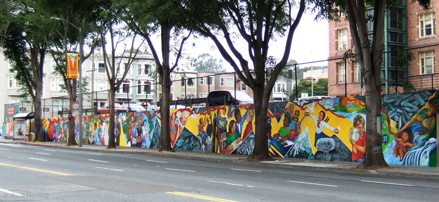 Educate to Liberate , John Adams Community College, corner Masonic & Hayes, San Francisco, California. 400 ft. Haight Ashbury. Muralists: Miranda Bergman, Jane Norling, Arch Williams, Vicky Hamlin, Maria Ramos, 1988/2006. Masonic view.