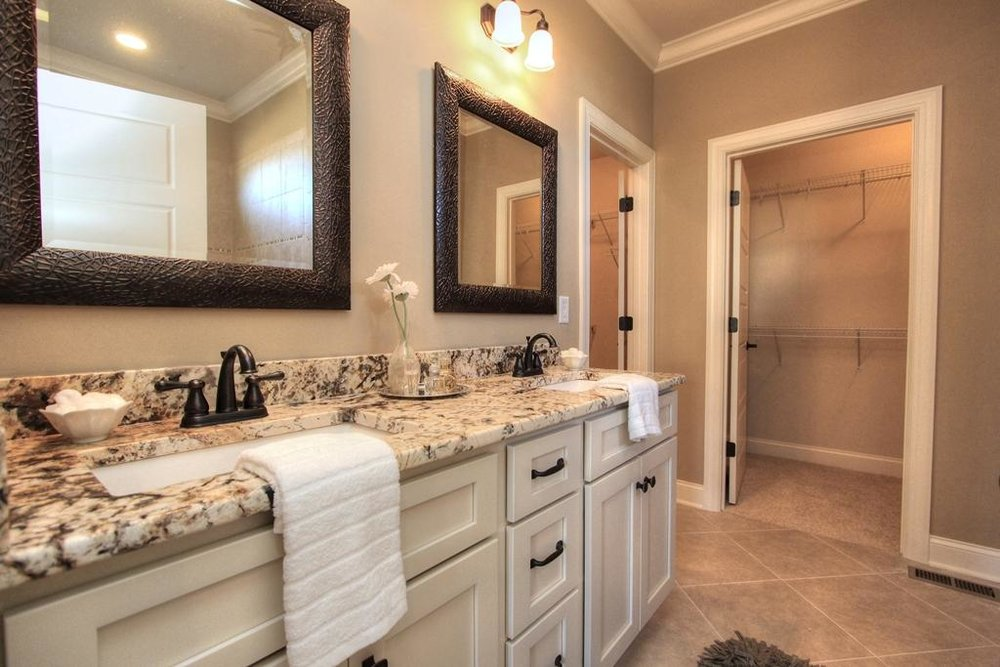 bathroom - Pack up medicines that aren't needed, put away jewelry and toiletries, clean grout and check plumbing