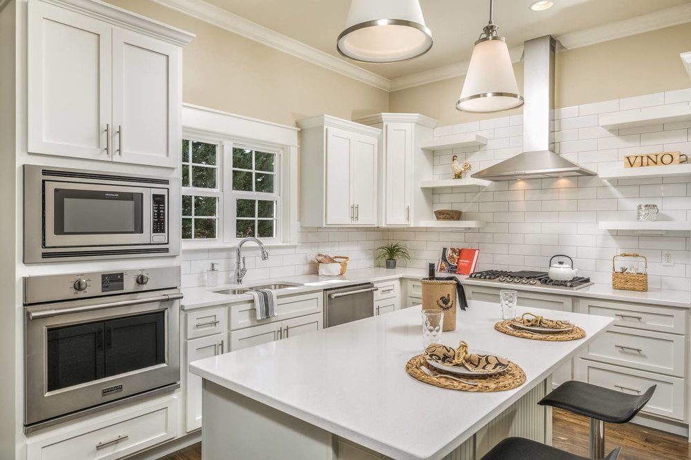 kitchen - Touch up paint on walls and cabinets, update hardware, clear counters of small appliances and clutter