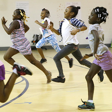 (L-R) Mylexus Mayo, Tanarie Pryor, Ashante Moorman and Jhalina Gregory exercise during Say It With Heart Summer Camp at Fairfield Court Elementary School Tuesday, August 9, 2016. The program is put on by Challenge Discovery Projects.  Photo by Alexa Welch Edlund; courtesy of Richmond Times-Dispatch.