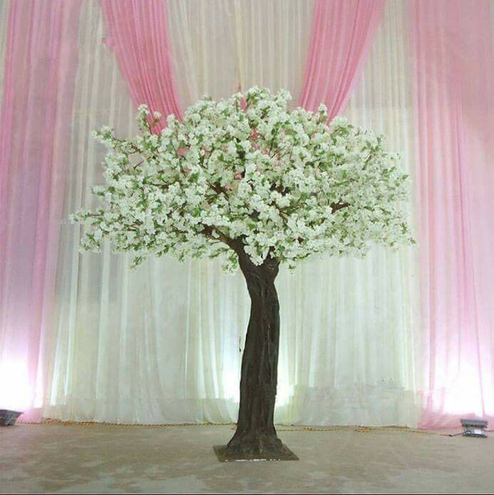 White Blossom   A winding sculpted resin trunk leads up to handcrafted wooden branches from which smaller branches, impeccably realistic leaves and clouds of silk mix blossoms come tumbling in different organic sizes and tones. The Blossom trees are glorious, romantic and uplifting.