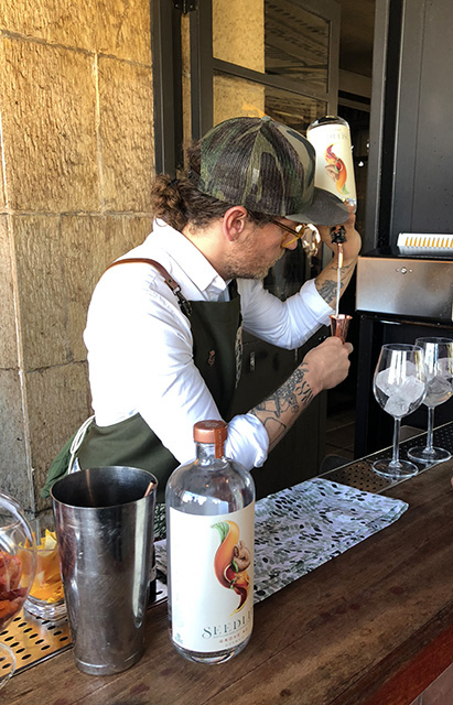 Ben Branson, Founder of Seedlip Making Cocktails at the Launch Party for Grove 42 on September 10 at the Ace Hotel in Los Angeles.