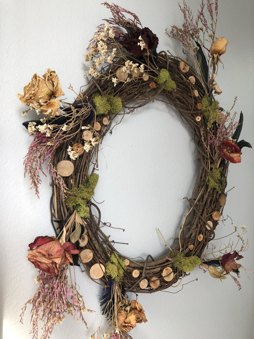 Growth is Circular by Melissa Hargus. Dried Flowers, Moss, Feathers and Wood.