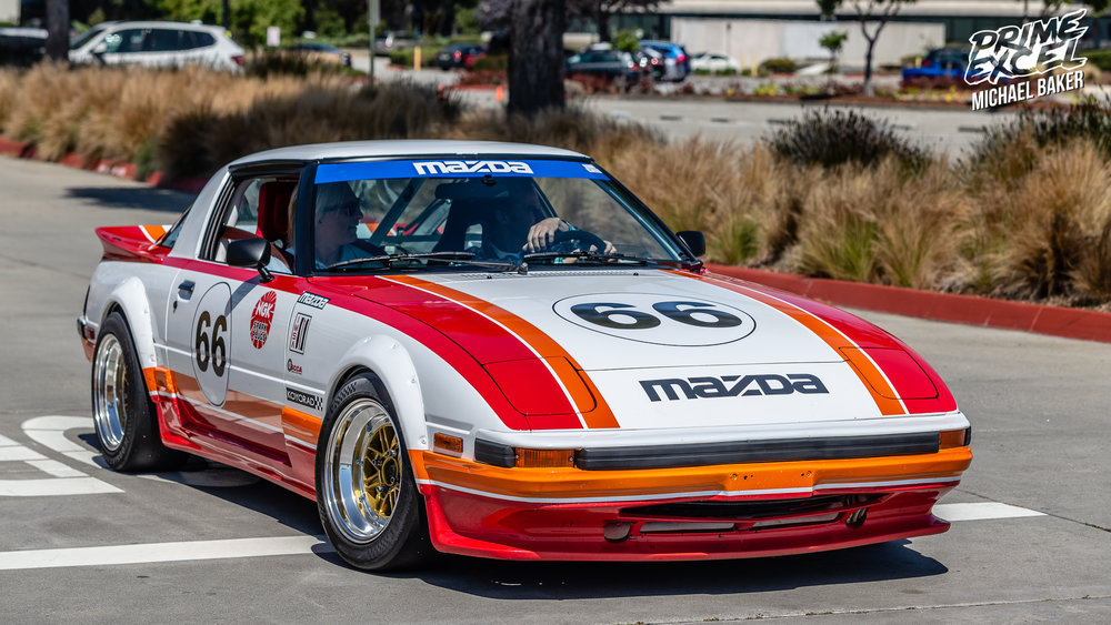 This FB Mazda RX-7 exemplifies styling of a bygone era with pop-up headlights, thin pillars, small wheels and a period-correct livery.