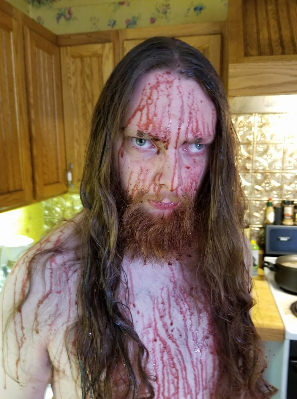 """Don Millikan III (Gleahan) had to get bloodied up for one scene late in the movie. We had help from our resident blood expert, Brandon Cole (director, """"Bring Them To Me"""", not pictured), who was just a  little  too excited when we shot this scene."""