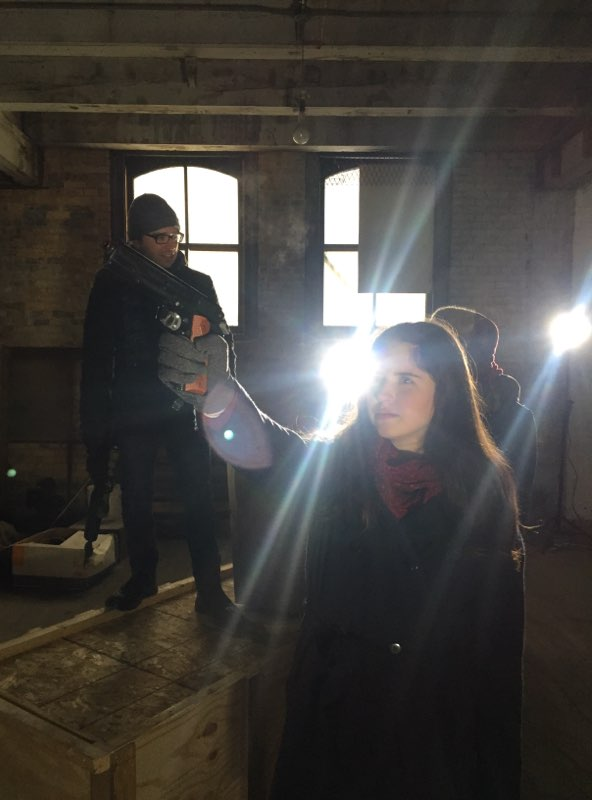 The Warehouse Sequence was one of our most intense days of shooting, but we still managed to squeeze in a little fun. Here we see Henriette Soderlind (Penelope Johnson, bottom right) getting into character with a prop gun. (Background, top-left, is Executive Producer Matthew Dressel)