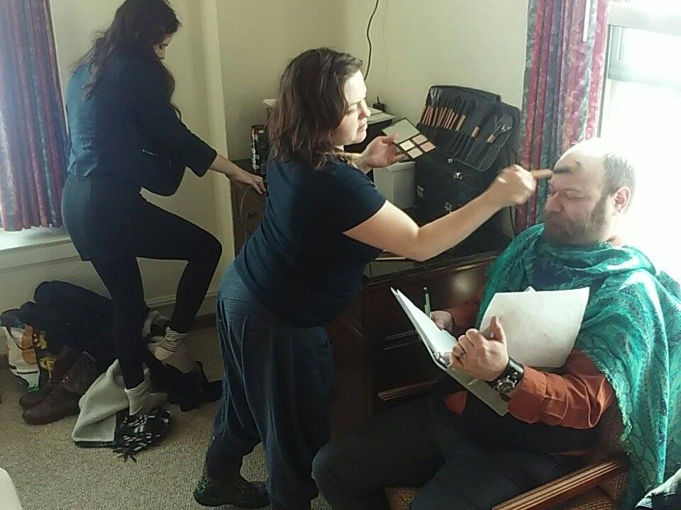 David Aldridge (Nathaniel) is actually in his 30s, so we had to age him for every scene using makeup effects. Here, makeup artist Naomi Leininger applies the finishing touches to David's look as Henriette Soderlind (Penelope) changes for the next scene.