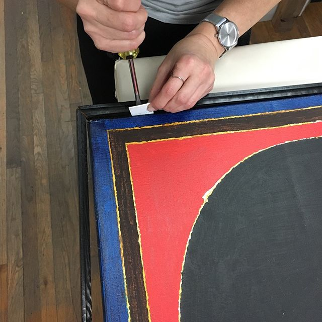 Quite honestly we weren't so happy about removing the original frame off of this S.H. Raza painting, but the client is always right...right? 🤷🏻‍♀️🤷🏻‍♂️ #archivalframing #fineart #painting #shraza