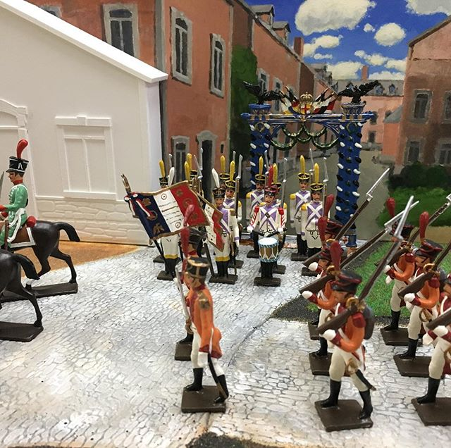 We've reopened after a month-long summer vacation and we're back to....playing with toy soldiers. We're almost done painting the background for this diorama we built. Thoughts? #fineart #WIP #toys