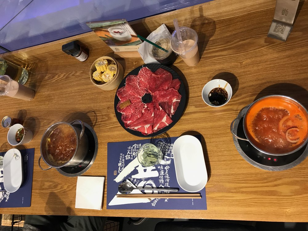 We ended the day with hot pot - we went to a fancy hot pot spot in the mall where they gave you your own individual hot pots. So cute! I had the tomato soup base (because I don't like too much spice) and Kevin had the house soup base (because he LOVES a good kick).