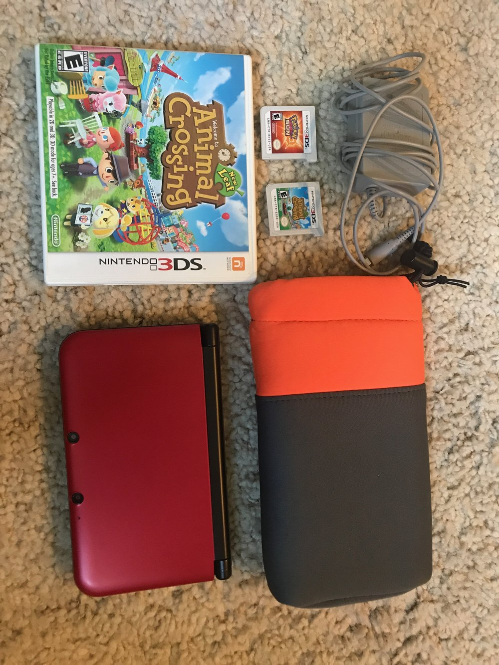 $120 LIKE NEW Nintendo 3DS XL Red with protective case and 2 games (animal crossing new leaf and Pokemon Sun) - RETAIL: $200