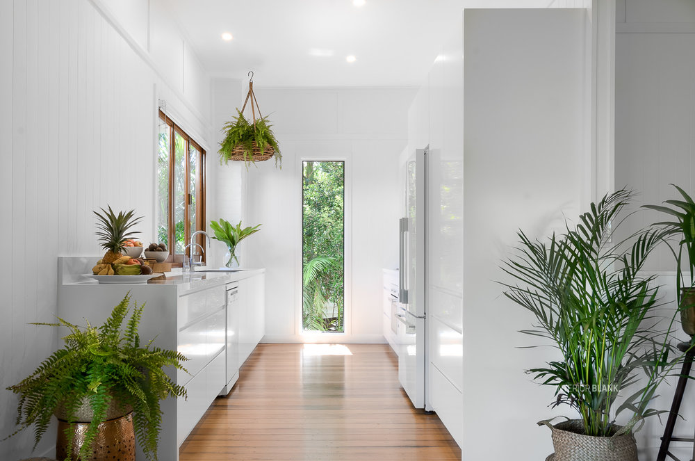 Kitchen renovations Bangalow_White satin 2pac cabinets_fingerpull handles_Quantum Quartz Stone benchtops_VJ wall Panelling_white kitchens. New vertical window. You should see the before and afters of this kitchen!
