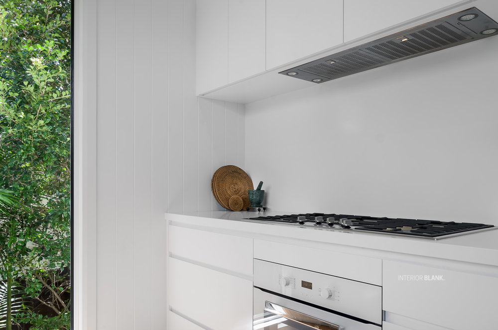 Kitchen renovations Bangalow_White satin 2pac cabinets_fingerpull handles_Quantum Quartz Stone benchtops_VJ wall Panelling_white kitchens. storage solutions, exposed white brickwork